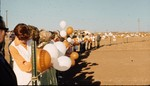 UTPB's Groundbreaking Attaching Orange and White Balloons